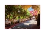 Tavernas under the flowers in Kos Town